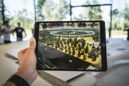 Image of a hand holding an iPad with an image displayed on it